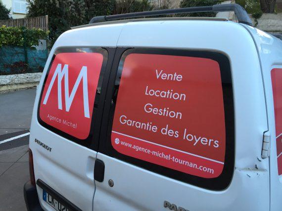 Marquage véhicule pour l'agence Michel arrière