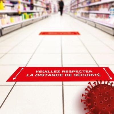 Mise en situation du modèle rouge rectangle - pieds pour l'adhésif de sol information coronavirus - covid19